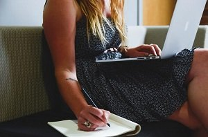 girl working on macbook